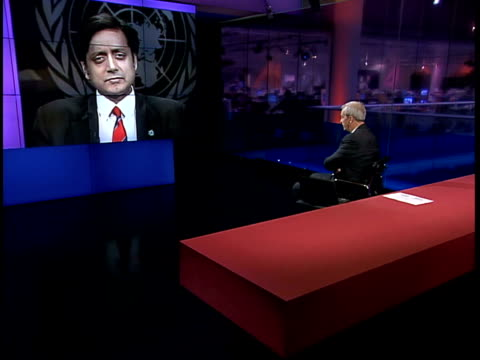 stockvideo's en b-roll-footage met channel 4 news; live 2-way studio/united nations usa: new york: united nations: int shashi tharoor interview sot - dismayed/ iraqi people need to... - patriotism
