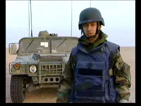 day 3 lunchtime news bulletin carl dinnen nasiriyah videophone us armoured vehicles iraq nr nasiriyah dinnen speaking from deserte jeep in b/g pan... - nasiriyah stock-videos und b-roll-filmmaterial