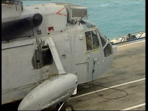 day 3 lunchtime news bulletin sea king helicopter on deck of warship as rotors spinning pan sea king helicopter taking off from deck of warship hms... - helicopter rotors stock videos and b-roll footage