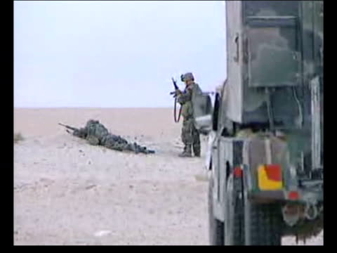 day 3 lunchtime news bulletin iraq nr nasiriyah bv us soldiers in defensive positions in sand as one along in f/g us fighting vehicle stationary ms... - nasiriyah stock-videos und b-roll-filmmaterial