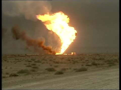 day 3 lunchtime news bulletin uk pool iraq rumaila lgv fire burning at rumaila oil field coalition truck rl past oil field burning in distance more... - iraq war stock videos and b-roll footage