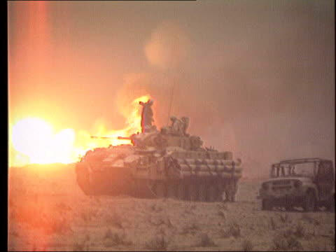 day 4 channel 4 news lib february 1991 allied tanks in desert with fire burning in background ground to air american tankbuster bomber flying over - 2003 stock videos and b-roll footage
