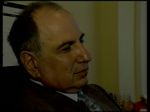 day 5 channel 4 news itn ahmed chalabi watching news report on tv - day 5 stock videos and b-roll footage