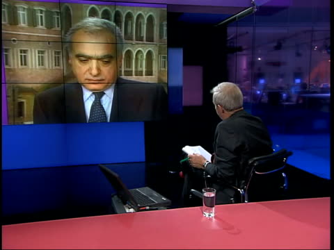 channel 4 news; live 2-way studio/beirut lebanon beirut int ghassan salame interview sot - american propoganda is not trusted in middle east but they... - weapons of mass destruction stock videos & royalty-free footage