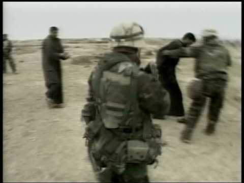 day 5 channel 4 news 'please refer to current editorial guidelines or editorial management before using pow pictures' iraqi pows made to kneel on... - iraq war stock videos and b-roll footage