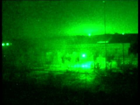evening news; pool iraq: al faw night green nightscope shots british marines firing on iraqi position during gun battle - 5日目点の映像素材/bロール
