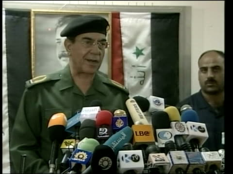 day 5 lunchtime news pool baghdad mohammed saeed alsahaf press conference sot we will continue showing whatever of their mercenaries fall into our... - nasiriyah stock-videos und b-roll-filmmaterial