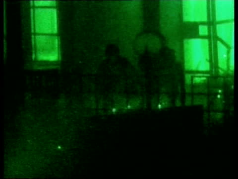 lunchtime news; pool night green nightscope shots flash as explosion inside building soldier running from burning building germany: ramstein air base... - 5日目点の映像素材/bロール