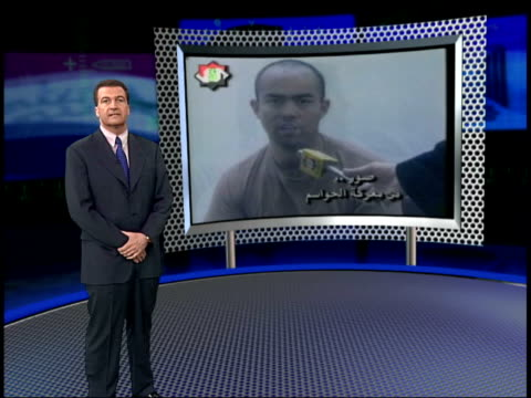 news at nine; itn england: london: gir i/c with vrg graphic showing pictures of pows - day 5 stock videos & royalty-free footage