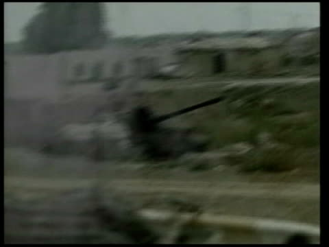 day 5 news at nine iraq nassiriya gvs bridge with us soldiers beneath gv smoke rising from explosion on building in distance zoom in gv column of us... - day 5 stock videos and b-roll footage