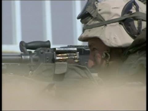 vidéos et rushes de news at nine; itn for itv iraq: umm qasr ext gv british marines towards on quad bikes gv marines along past on back of truck gv armoured vehicles... - irak
