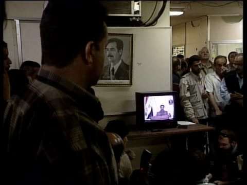 news at nine; itn iraq: baghdad int iraqi men watching saddam hussein's television broadcast in room ext man listening on radio int men watching... - day 5 stock videos & royalty-free footage