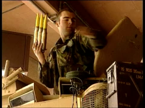 day 7 evening news iraq basra seq british soldiers checking equipment and ammunition in warehouse lance corporal richard watson interviewed sot... - ammunition stock videos & royalty-free footage