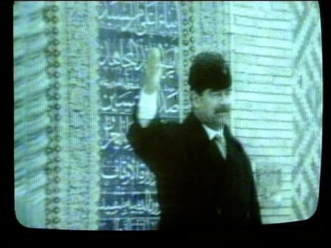 day 7 evening news cs screen showing iraqi state tv pictures celebrating saddam hussein - saddam hussein stock videos & royalty-free footage