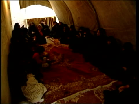evening news; itn for itv iraq: baghdad int iraqi women crying during funeral wake for marketplace bombing victim - itv evening news stock-videos und b-roll-filmmaterial
