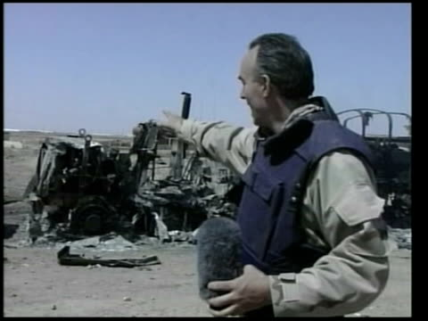 day 8 news at nine /nbc iraq nassiriya dusk us helicopters along overhead flares in night sky gvs charred remains of us supply truck hit in friendly... - iraq war stock videos and b-roll footage