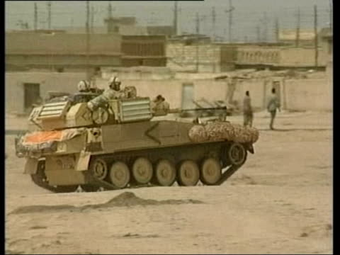 evening news; lib basra explosion british apc along british soldiers patrolling - イラク点の映像素材/bロール