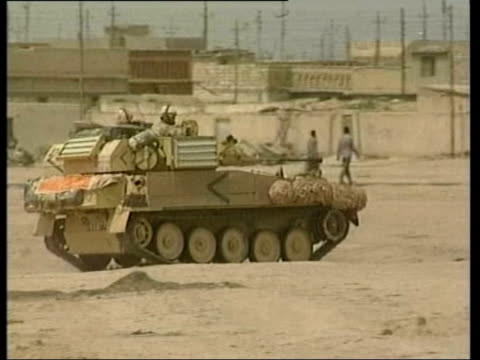 day 9 lunctime news lib basra explosion british apc along british soldiers patrolling - 2003 stock videos and b-roll footage