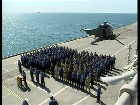 Day 9 Lunctime News Sailors on deck of HMS Ark Royal during ceremony for servicemen who died in Sea King helicopter crash Coffin of dead serviceman...