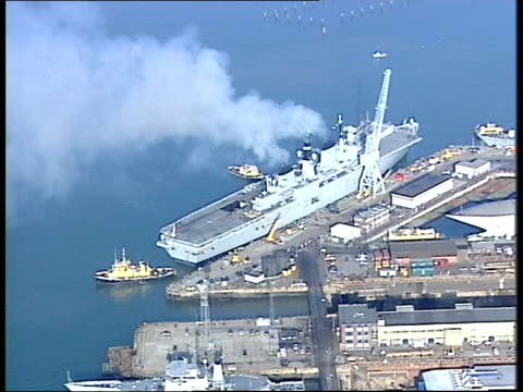day 9 news at nine lib england portsmouth views hms ark royal leaving port families waving off air view hms ark royal leaving port - day 1 stock videos and b-roll footage