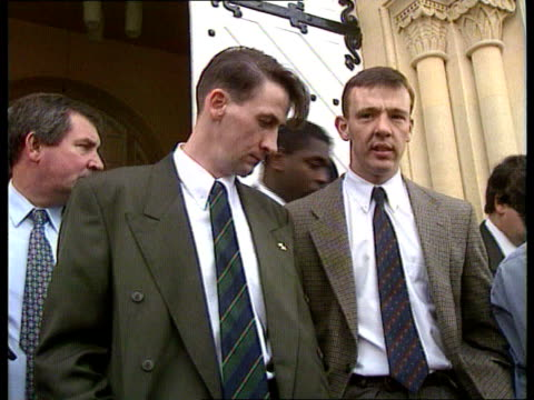 friendly fire deaths; england oxon oxford parents of soldiers killed in friendly fire incident towards coroner's court track back l-r cms lance corp... - 検死官点の映像素材/bロール