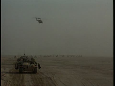 friendly fire deaths nao iraq gv british armoured column along thru desert terrain ms warrior mechanised infantry combat vehicle leading line along... - iraq stock videos & royalty-free footage