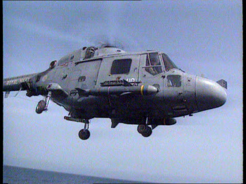 G/A Lynx helicopter taking off from deck of ship TILT UP Cameraman Eugene Campbell awarded MBE CMS ITN Reporter Michael Nicholsonawarded the OBE