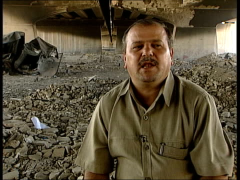 iraqi soldiers talk of collapse of army itn williams along with former iraqi colonel and translator under road bridge where he was based with his... - 言語翻訳点の映像素材/bロール