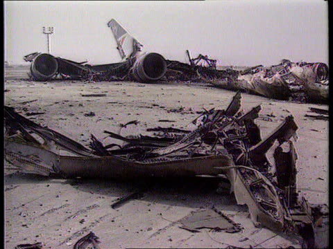 Gulf War stranded BA flight 149 KUWAIT Airport LMS Wreckage of Flight BA149 on tarmac MS More wreckage CMS Wheel with more wreckage behind CMS Engine...