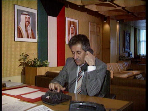 cms kuwait ambassador ghazi alrayes at desk using telephone tbv kuwaiti ambassador using phone - botschafter stock-videos und b-roll-filmmaterial