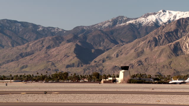 A Gulfstream jet taxis on a runway.