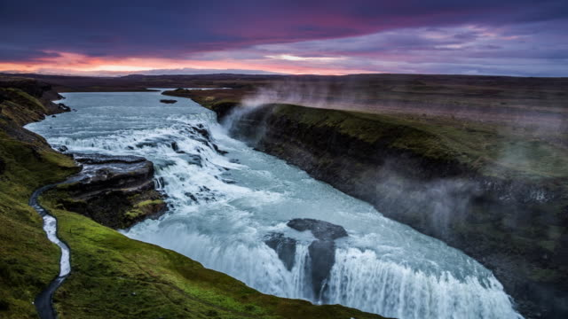 gullfoss waterfall in iceland at sunrise - iceland stock videos & royalty-free footage