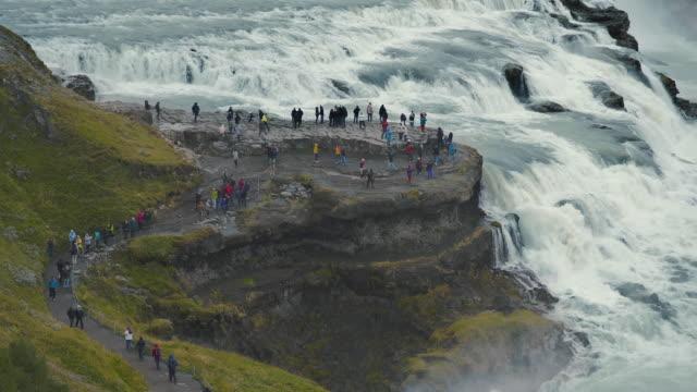 gullfoss waterfall in iceland - tourist stock-videos und b-roll-filmmaterial