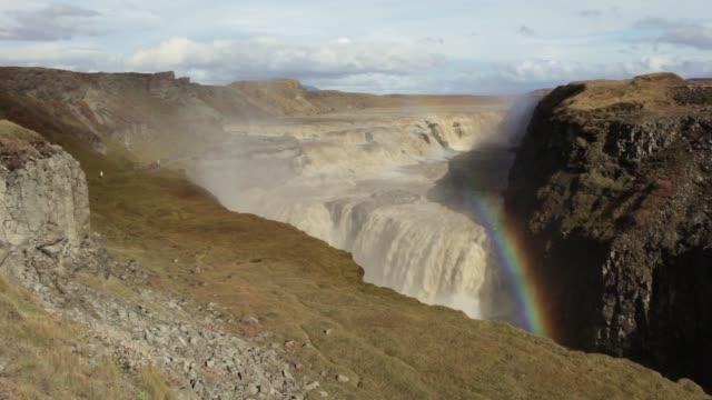 Gullfoss waterfall rainbow over Hvita river visiting tourists Iceland