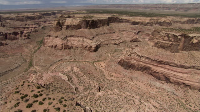 gullies streak the scrublands and canyons of utah. available in hd - shrubland stock videos & royalty-free footage