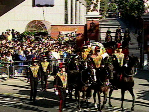 A gun carriage carrying Princess Diana's coffin is led out of Kensington Palace by soldiers from the Welsh Guards 06 September 1997