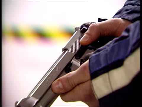 gun crackdown expected in wake of birmingham shootings int cs handgun held and cocked pistol handled cs gun held as trigger pulled ext i/c - trigger stock videos & royalty-free footage