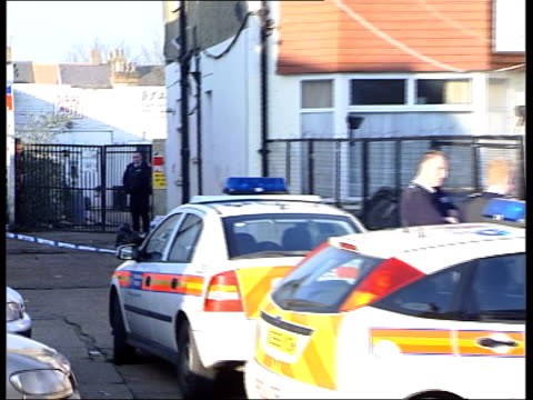 gun crackdown expected in wake of birmingham shootings london hounslow police officer standing guard at scene of shooting pull out police cars and... - gun crime stock videos & royalty-free footage