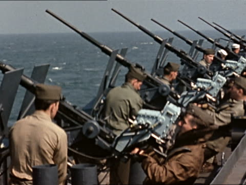 WWII gun crew aiming line of 20 mm guns on USS Yorktown during gunnery practice