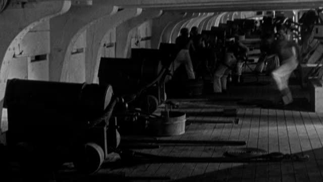 gun crews run to the cannon below deck in the uss constitution during a naval battle. - artillery stock videos & royalty-free footage