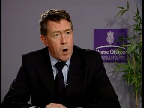 35 per cent rise in incidents / manchester project itn london home office john denham mp interview on rising gun crime sot - gun crime stock videos & royalty-free footage