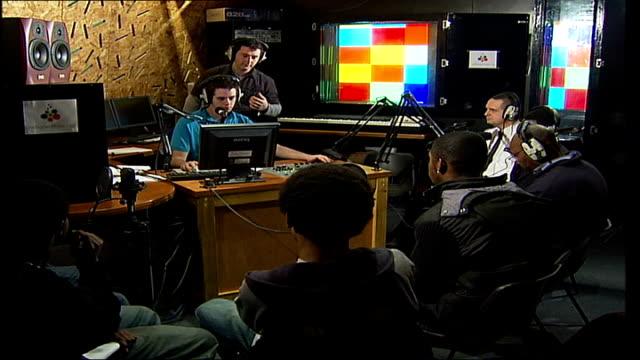 south london gangs backgrounder england london peckham int controls and lights on mixing desk teenagers sitting around dj in radio peckham studio dj... - radio studio stock videos & royalty-free footage