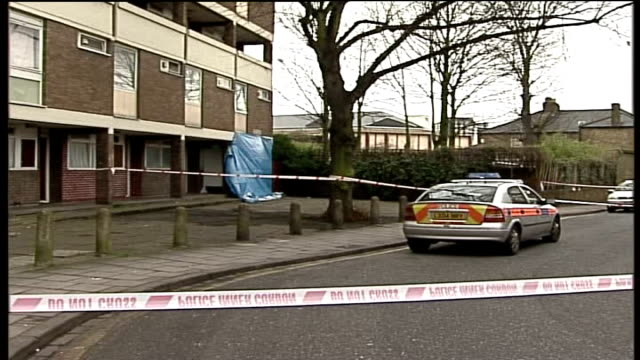 gun crime task force set up after third teenager shot in south london; blue tarpaulin covering side of cox's home with police car, cordon in... - 防水シート点の映像素材/bロール
