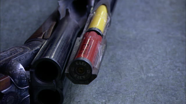 a gun expert points to damage from an incorrect cartridge in a shotgun barrel. - cartridge stock videos & royalty-free footage
