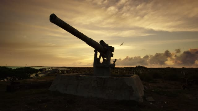 a gun from the battle of midway during world war ii remains on eastern island, midway atoll national wildlife refuge and battle of midway national memorial. part of papahanaumokuakea marine national monument. - artillery stock videos & royalty-free footage