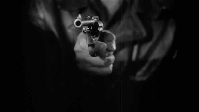 1953 cu - a gun is pointed at a mans face - mord stock-videos und b-roll-filmmaterial