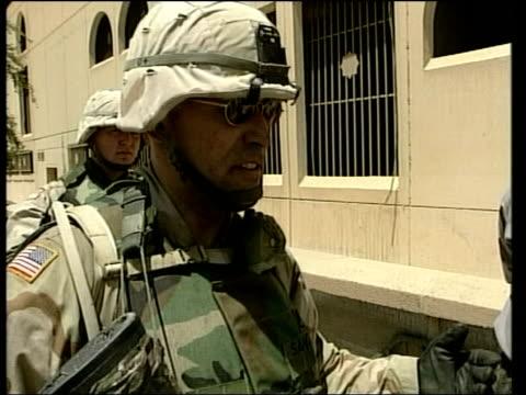 juliet bremner iraq baghdad ext us soldier handcuffing iraqi men lying on ground la soldier holding seized assault rifle soldier handing seized... - バグダッド点の映像素材/bロール