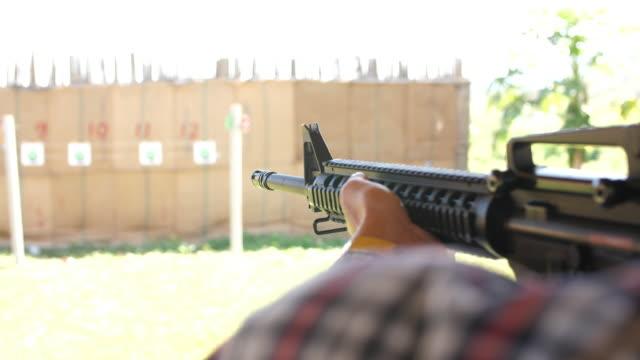 gun ready for shooting, 4k - m16 stock videos & royalty-free footage