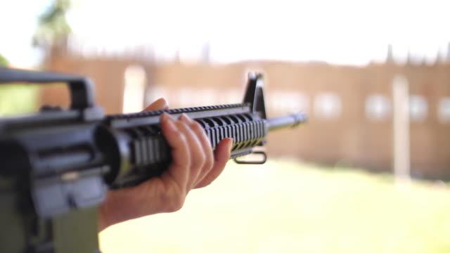 gun ready for shooting, 4k - terrorism stock videos & royalty-free footage