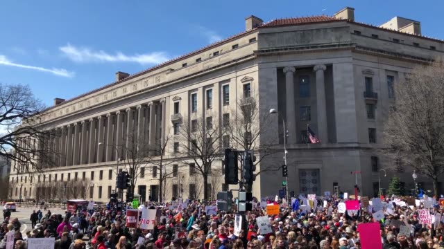 gun reform advocates line pennsylvania avenue while attending the march for our lives rally march 24, 2018 in washington, dc. hundreds of thousands... - march for our lives stock videos & royalty-free footage